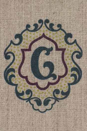 """G"" stamped on linen"