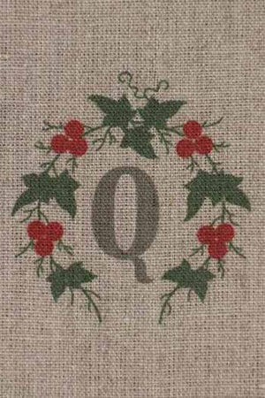 """Q"" stamped on linen"