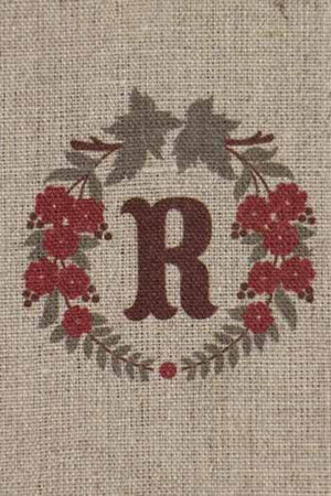 """R""  stamped on linen"
