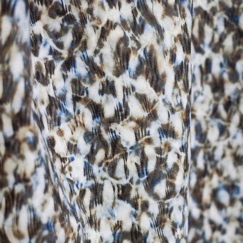 "Carley Kahn ""Scallop"" upholstery fabric. Blue and tan colorway."