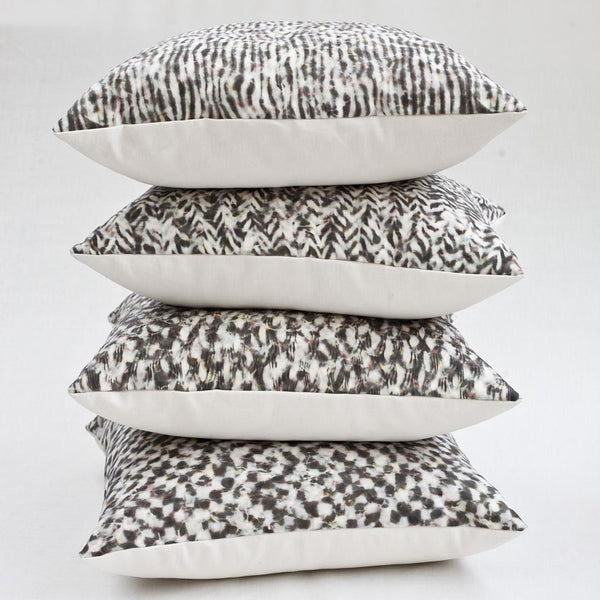 Carley Kahn pillow covers. Four of them stacked. Rose and gold colorway.
