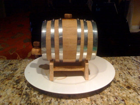 Miniature one liter white oak barrel filled with vodka for aging