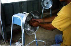Grinding coconut meat from the shell
