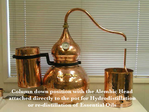 copper alembic distiller with the column down