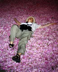 Dorene is overwhelmed by the aroma of fresh rose petals.