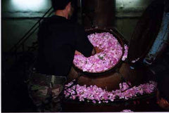 Rose petals are added to the retort