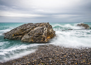 A long exposure of a storm swell breaking on the coast of Liguria