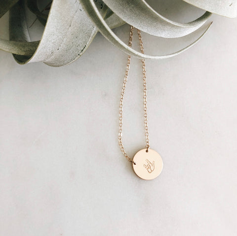"gold necklace with ASL ""i love you"" hand sign"