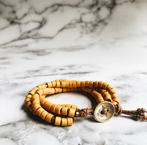 mustard mykonos leather wrap bracelet