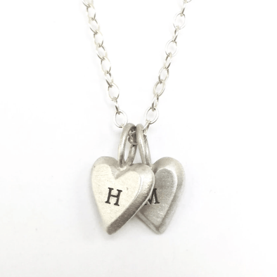 Personalized Tiny Heart Necklaces by Emily Rosenfeld In English