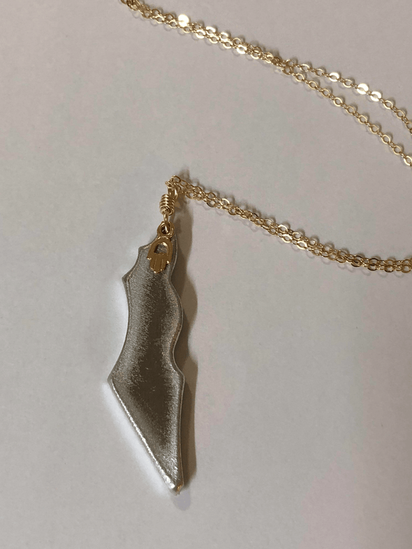 Rocket Hamsa Necklace: Turning Hate into Love