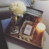 the motherhood collective display table candle champagne gift idea mother's day flowers