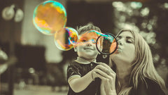 Mum and son playing with bubbles