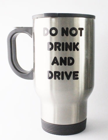 a silver travel mug that says 'Do not drink and drive, Unless it has milk two sugars'