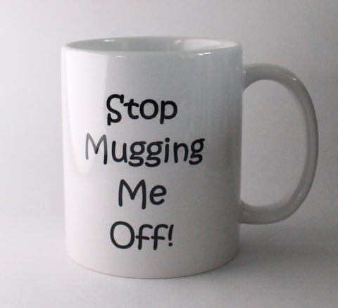 white standard mug with 'stop mugging me off' on the front and back