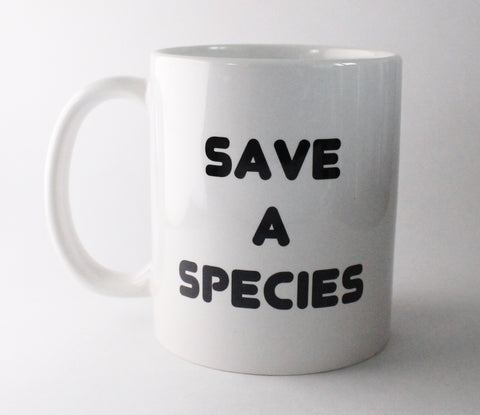 White standard mug on the front saying save a species