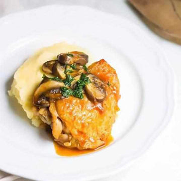 Chicken chasseur with mash and kale