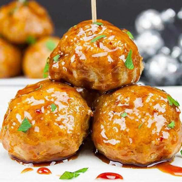 Firecracker chicken meatballs served with a tangy chilli sauce and served with Fragrant Rice
