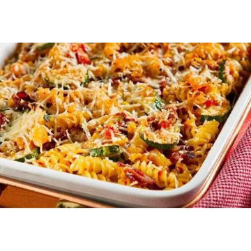 Vegetable pasta with courgettes, tomato, peppers and Parmesan