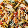 Penne Alfredo- chicken in a creamy Pesto Sauce with Cherry Tomatoes