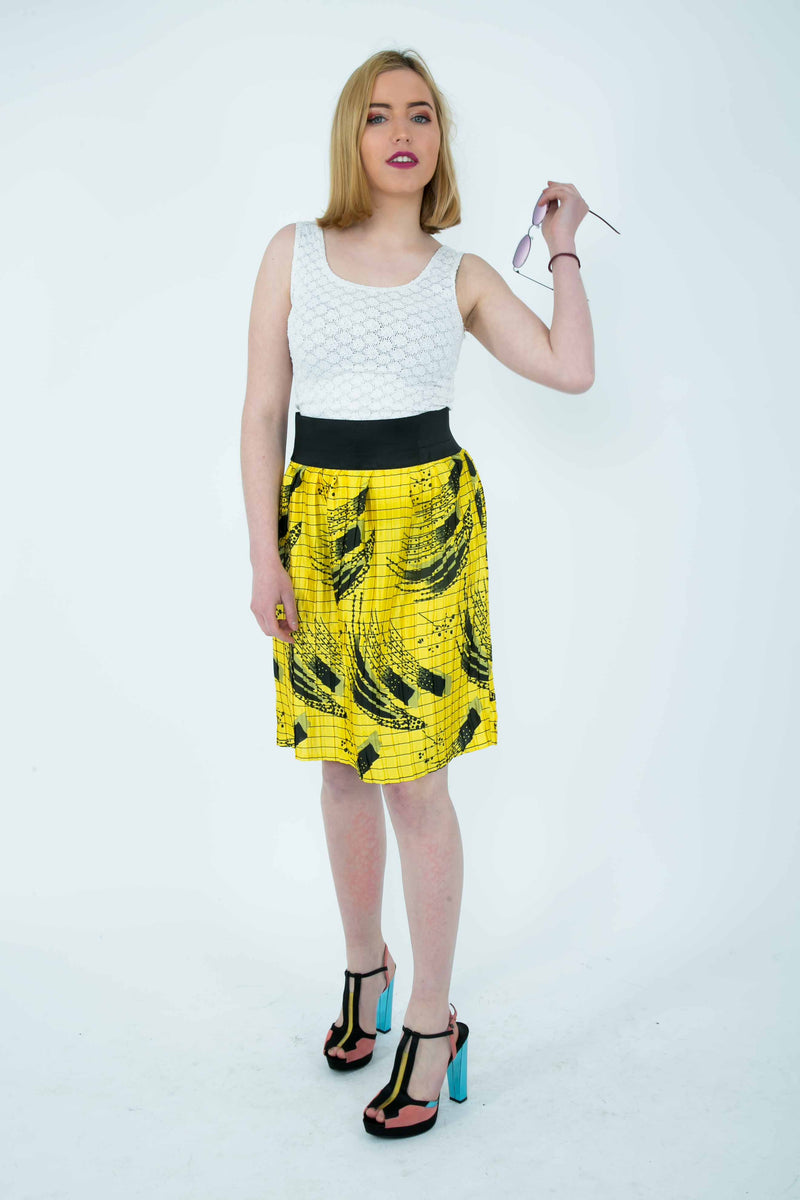 Temad collections Ankara yellow silk pleated mini skirt with pockets and elasticated band