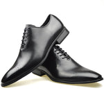 Men's wholecut semi-Brogue shoes in black faux leather placed one on top of the other