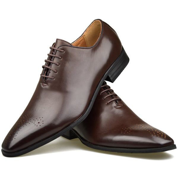 Men's wholecut semi-brogue shoes in brown faux leather placed one on top of the other