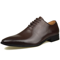 Men's wholecut semi-brogue shoe in brown faux leather at an angle facing left