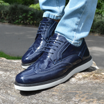 IMAGE 1 of round-toe brogue trainer in navy faux patent leather