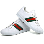 Men's three stripe embroidered trainers in white faux leather with white heel placed one on top of the other
