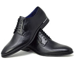 Men's black blucher faux leather shoes placed one on top of the other