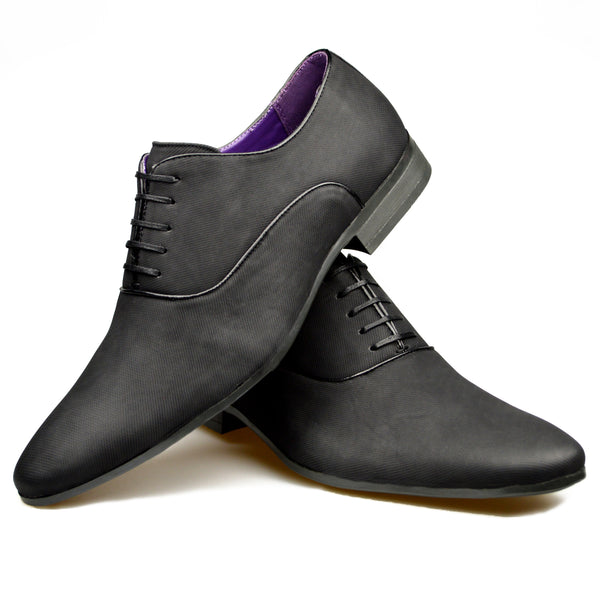 Men's patterned Oxford shoes in black faux leather placed one on top of the other