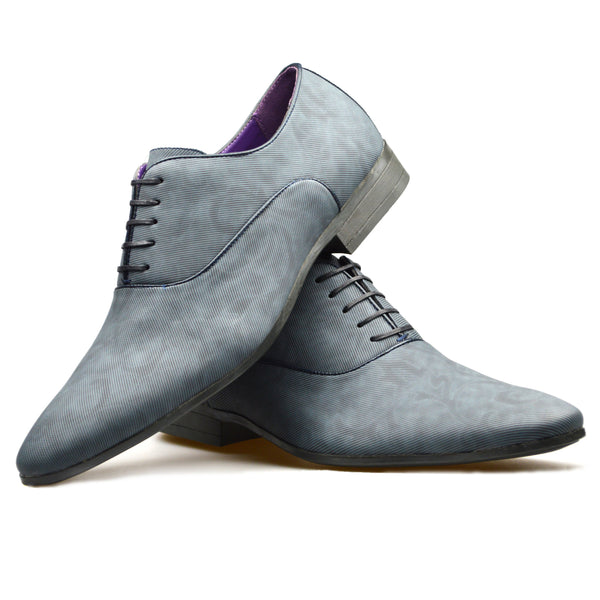 Men's patterned Oxford shoes in blue faux leather placed one on top of the other