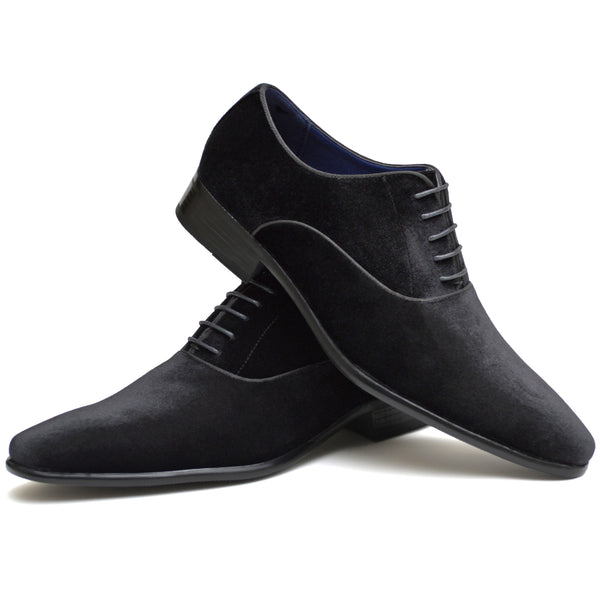 Men's classic Oxford shoes in black faux suede placed one on top of the other