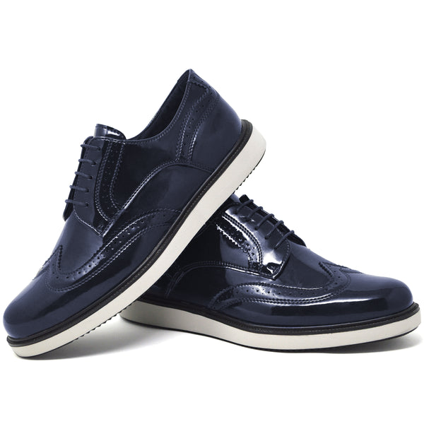 IMAGE 5 of round-toe brogue trainer in navy faux patent leather