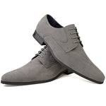 Men's plain-toe Derby shoes in grey faux suede placed one on top of the other