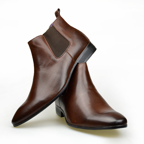 Men's classic Chelsea boots in brown faux leather placed one of top of the other