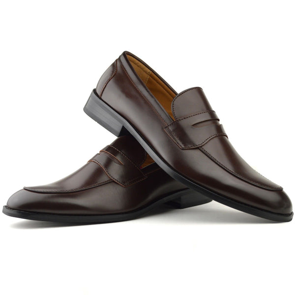 Men's classic penny loafer shoe in brown faux leather placed one on top of the other