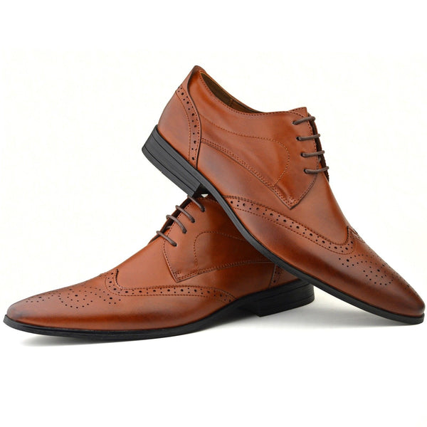 Men's wingtip brogue shoes in tan faux leather placed one on top of the other