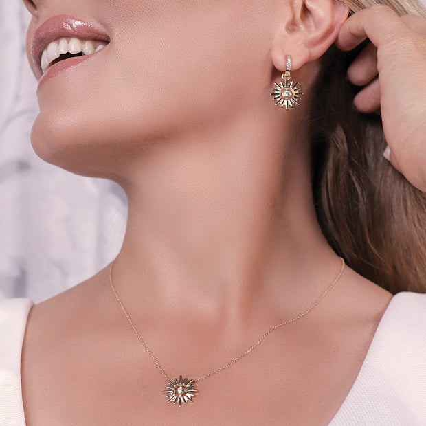 Woman wearing Your Heavenly Light Halo by HALOTOPIA Charm Earrings in 14K Yellow Gold