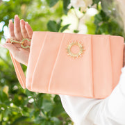 Halo by HALOTOPIA peach pleated leather wristlet clutch bag featuring HALOTOPIA gold toned handbag hardware and the original Halo by HALOTOPIA symbol.