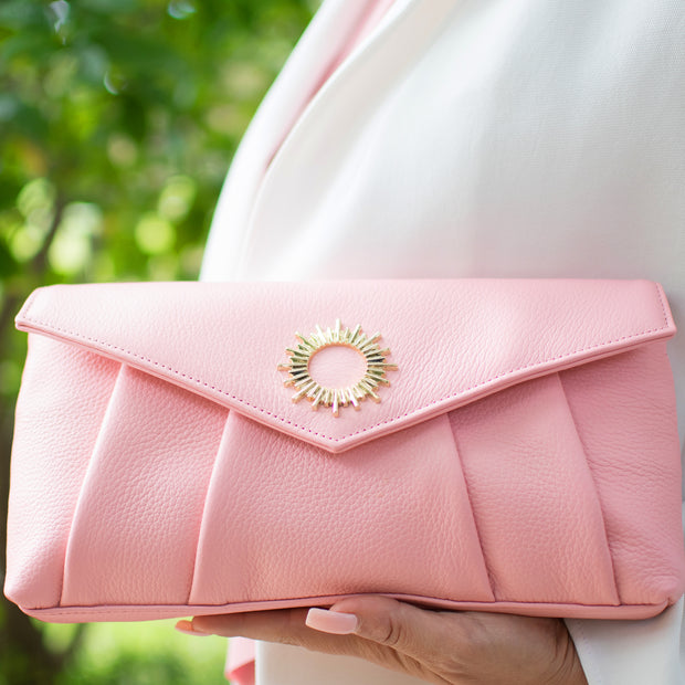 Halo by HALOTOPIA pink leather clutch bag in pebbled leather featuring the iconic Halo by HALOTOPIA golden hardware symbol