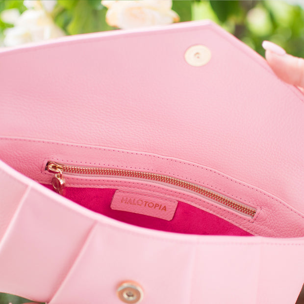 Halo by HALOTOPIA pink pebbled leather clutch bag interior view with zippered pocket