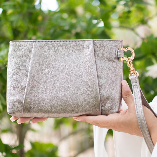 Back of Halo by HALOTOPIA silver pleated leather wristlet clutch bag. Removable wristlet strap.