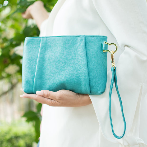 Reverse back view of the Halo by HALOTOPIA teal pleated leather wristlet clutch bag. Featuring HALOTOPIA gold toned hardware and removable wristlet strap.