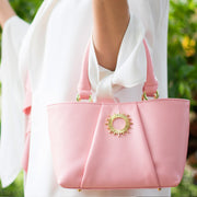 Pink colored Halo by HALOTOPIA small leather top handle tote bag featuring the Halo by HALOTOPIA symbol with pleated front leather design