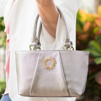 Silver Halo by HALOTOPIA small pebbled leather top handle tote bag with gold toned hardware featuring the Halo by HALOTOPIA symbol.