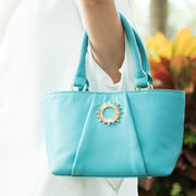 Teal colored Halo by HALOTOPIA small leather top handle tote bag with gold toned hardware featuring the original Halo by HALOTOPIA symbol.
