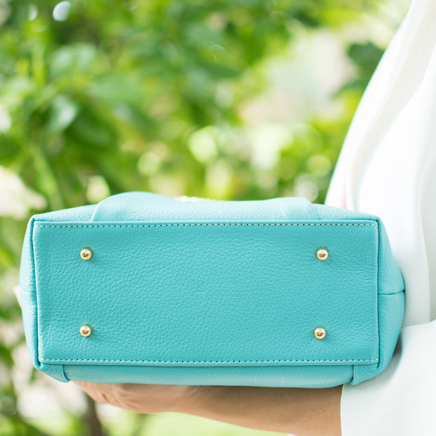 Teal small leather Halo by HALOTOPIA top handle tote with handbag feet.