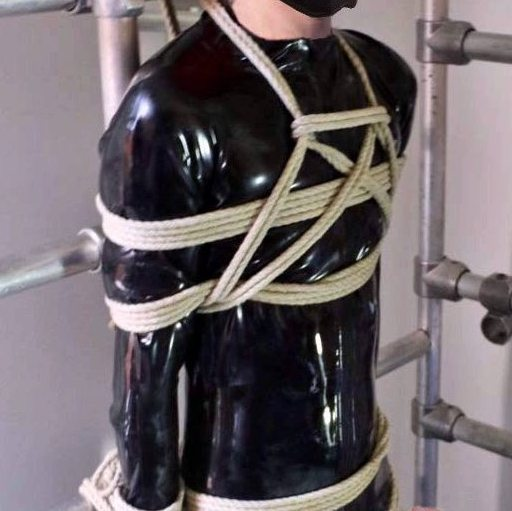 Bound and hard up in his leather ball stretcher